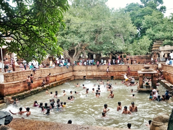 People Taking Dip in Mahakuteshwara Pond
